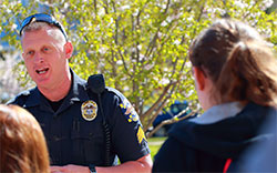Policeman talking on Centenary campus