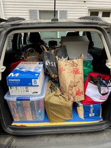 rear of car filled with food drive items