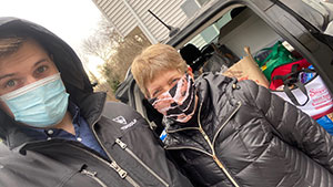 young man and woman wearing masks for Centenary Food Drive